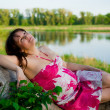 Pregnant woman in nature - Stock Photo