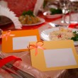 Empty place card on the white festive table — Stock Photo #40212607