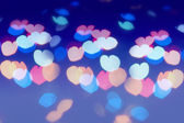 Colorful lens flare in the shape of heart — Stock Photo