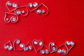 Hearts of paper quilling for Valentine's day — Stock fotografie
