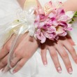 Wedding bouquet of orchids and roses in hand — Stock Photo #40225573