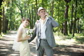 Beautiful young bride and groom — Stock Photo