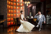 Bride and groom in interior — Stock fotografie