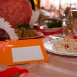 Empty place card on the white festive table — Stock Photo