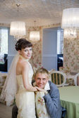 Bride and groom in interior — Stock Photo