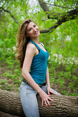 Beautiful young girl in park — Stock Photo