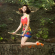 Stock Photo: Beautiful young girl on broomstick