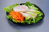 Chicken roulade on salad. — Stock Photo