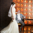 Stock Photo: Bride and groom in interior