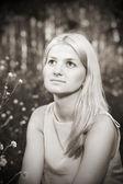 Beautiful young girl in meadow — Stock Photo