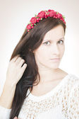 Young beautiful woman with flower wreath on head — Stock Photo