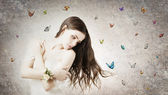 Beautiful bride with butterflies — Stock Photo