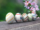 Easter colorful eggs on a wooden background — Stock Photo
