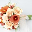 Colorful bouquet of orange calla lilies — Stock Photo