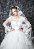 Beautiful woman in white wedding dress — Stock Photo