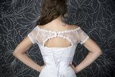 Beautiful woman in white wedding dress with corset — Stock Photo