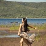Beautiful young girl runs along the beach — Stock Photo #48658871