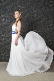 Beautiful woman in white wedding dress — Stock Photo