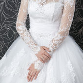 Lace white wedding dress with long sleeves — Stock Photo