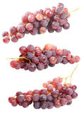 Tasty bunch of red grapes, isolated — Stock Photo