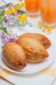 Three appetizing pie and orange juice — Stock Photo
