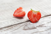 Strawberries on white wooden background — Stockfoto
