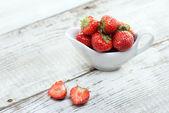 Strawberries on white wooden background — Stockfoto