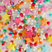 White background with multicolored sprinkles confectionery — Stock Photo
