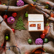 Baubles on rustic table with linen cloth — Stock Photo