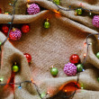 Golden baubles on rustic table with linen cloth — Stock Photo