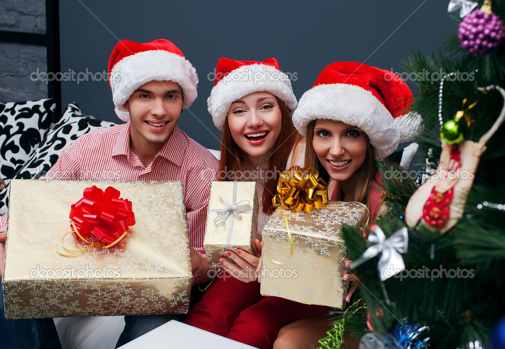 Happy Big family holding Christmas presents at home.Christmas tree — Stock Photo #14133044