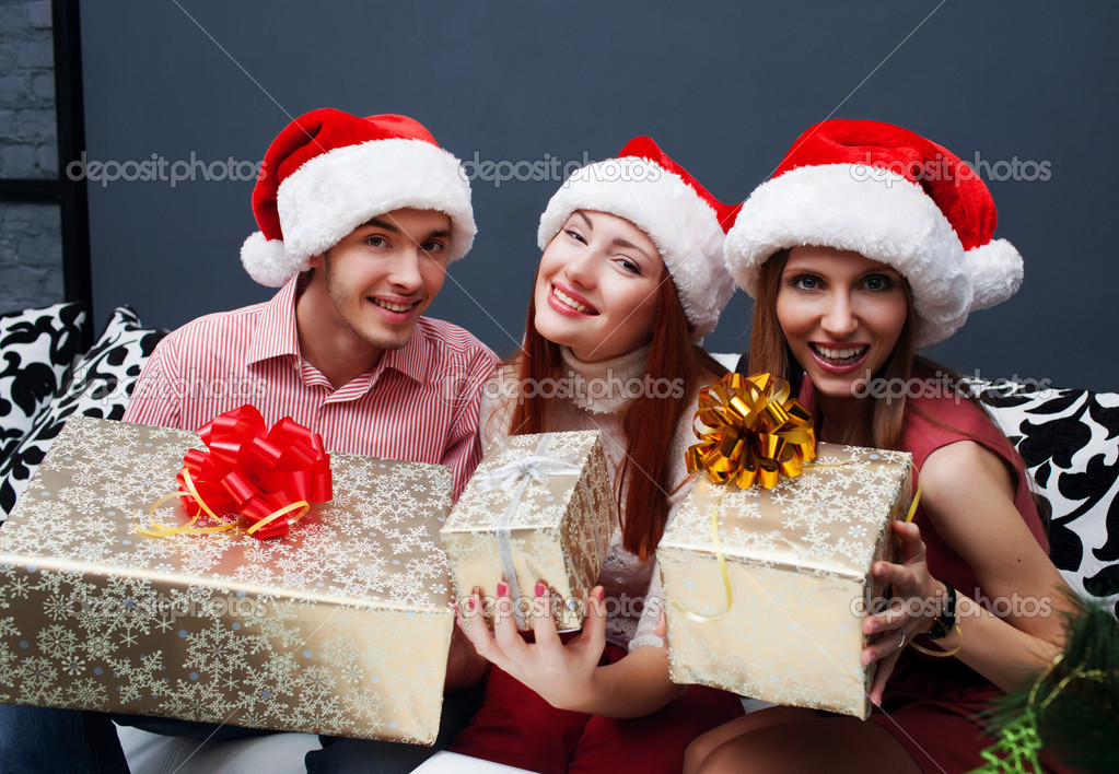 Christmas celebration. Friends with Christmas Gifts . New Year party — Stok fotoğraf #14133052