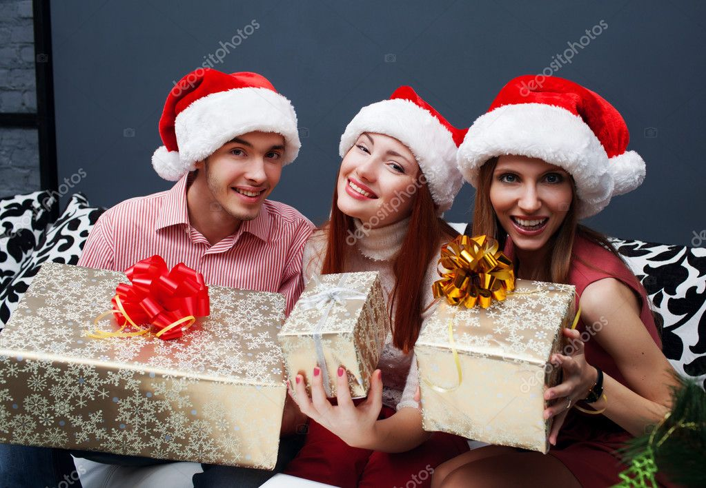Christmas celebration. Friends with Christmas Gifts . New Year party — Stock Photo #14133052