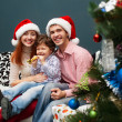 Happy Big family holding Christmas presents at home.Christmas tr — Stock Photo