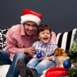 Smiling father and his son on Christmas — Stock Photo