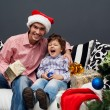 Smiling father and his son on Christmas — Stock Photo #14184996
