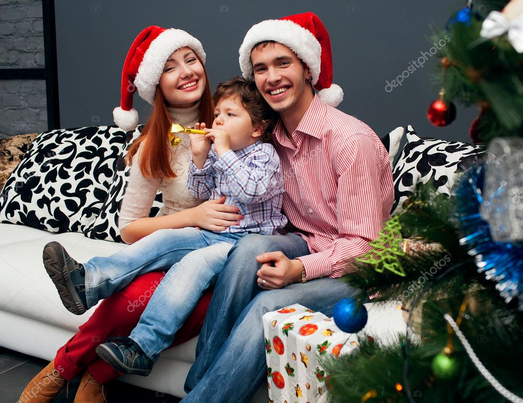 Young laughing family home with spruce on crastmas  Stock Photo #14185020