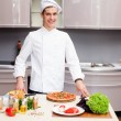 Portrait of smart chef preparing delicious meal for customer — Stock Photo