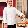 Chef cooks in the kitchen — Stock Photo