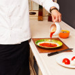 Stock Photo: Chef makes pizza. pour sauce