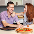 Royalty-Free Stock Photo: Happy young couple have fun in modern  kitchen indoor while prep