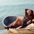 Attractive girl sailing on a yacht on summer day — Stock Photo