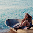 Beautiful sexy woman in a boat — Stock Photo