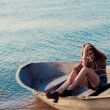 Beautiful sexy woman in a boat — Stock Photo #14206361