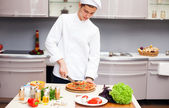 Young man in the kitchen preparing — Stock Photo