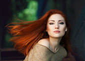 Portrait of a beautiful red-haired girl — Stock Photo