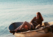 Beautiful sexy woman in a boat — Foto de Stock
