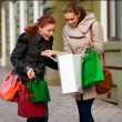 Stock Photo: Girls go to shopping