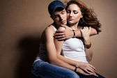 Portrait of a beautiful casual couple in jeans — Stock Photo