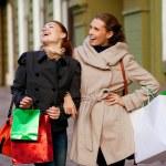 Girlfriends go shopping — Stock Photo #14345779